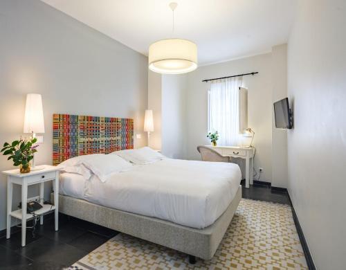 Cama ou camas em um quarto em ADC - Albergaria Do Calvário - member of Unlock Hotels