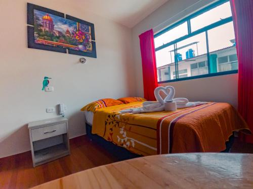 A bed or beds in a room at Residencial Marina House
