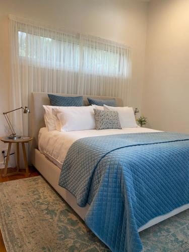 A bed or beds in a room at Messmates Luxury Eco Suites