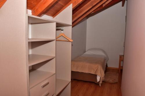 Una cama o camas cuchetas en una habitación  de Amarras