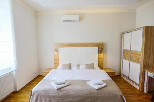 Postel nebo postele na pokoji v ubytování Hotel Mariel Znojmo