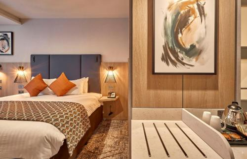 A bed or beds in a room at Crowne Plaza Reading East