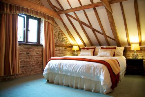 A bed or beds in a room at Colston Hall Farmhouse B&B