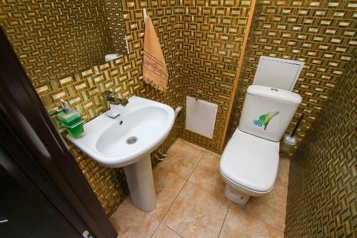 Ванная комната в Апартаменты на КАРОЛИНСКОГО