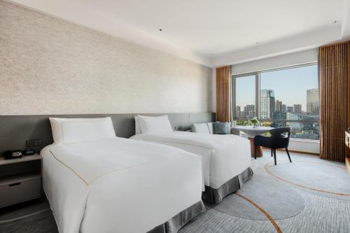 A bed or beds in a room at InterContinental Suzhou, an IHG Hotel