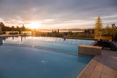 Der Swimmingpool an oder in der Nähe von Vacancéole – Le Domaine de Camiole