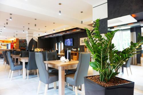 Ein Restaurant oder anderes Speiselokal in der Unterkunft Villa Winterpol