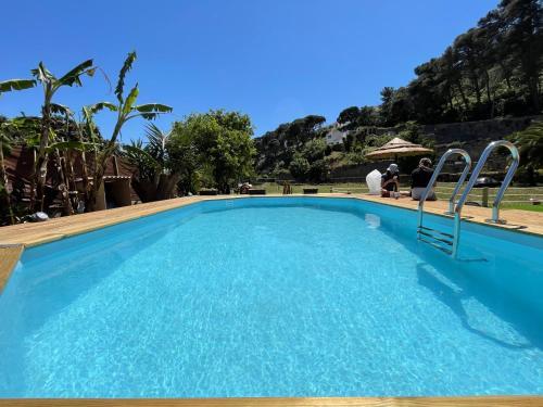 The swimming pool at or near Quinta da Villa