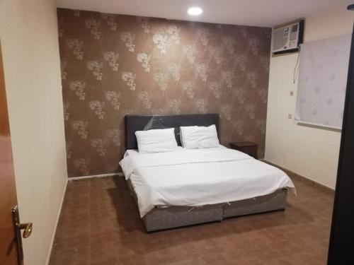 Cama ou camas em um quarto em Al Arjowan Hotel Units