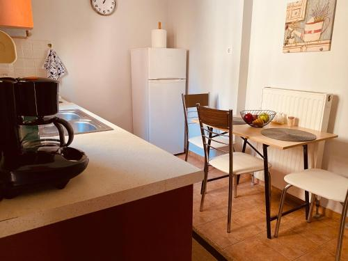 A kitchen or kitchenette at Unique Apartment with all Comforts!