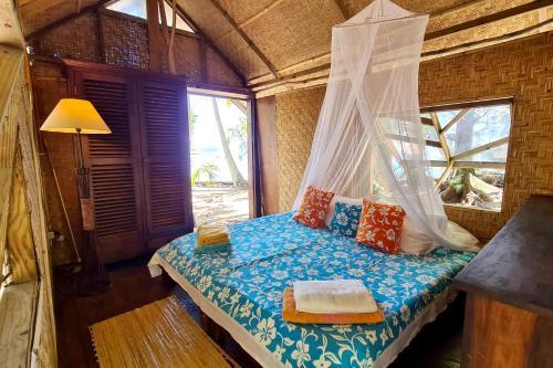 Cama ou camas em um quarto em Motu Mapeti - Tahiti Private Island