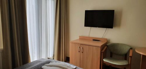 A television and/or entertainment centre at Villa Merry Spa&Wellness