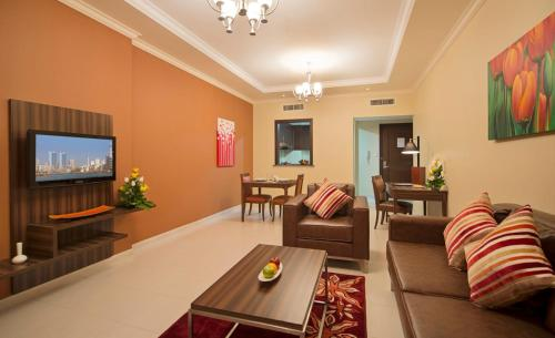A restaurant or other place to eat at Abidos Hotel Apartment Dubai Land