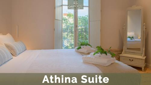 A bed or beds in a room at Carpofoli Corfu