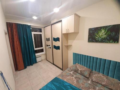 Кровать или кровати в номере 2-Bedroom Apartment