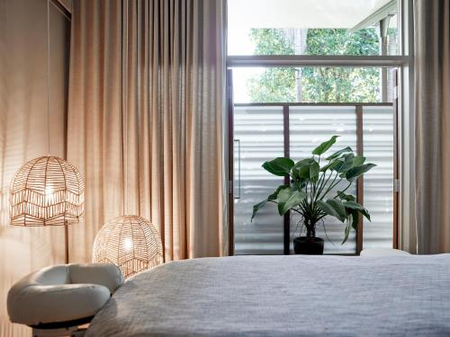 A bed or beds in a room at Crystalbrook Byron, Formerly Byron at Byron