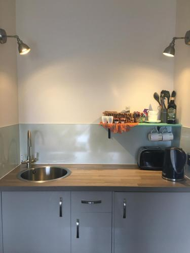 A kitchen or kitchenette at 40 Bernisdale - The Sabhal