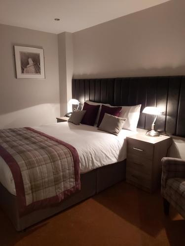 A bed or beds in a room at The Judds Folly Hotel, Sure Hotel Collection by Best Western