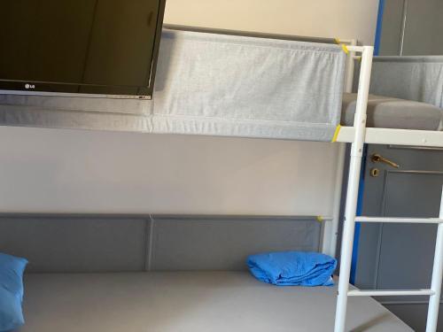 A bunk bed or bunk beds in a room at APPARTAMENTO VISTA MARE
