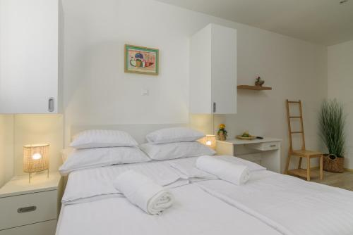A bed or beds in a room at Vila White