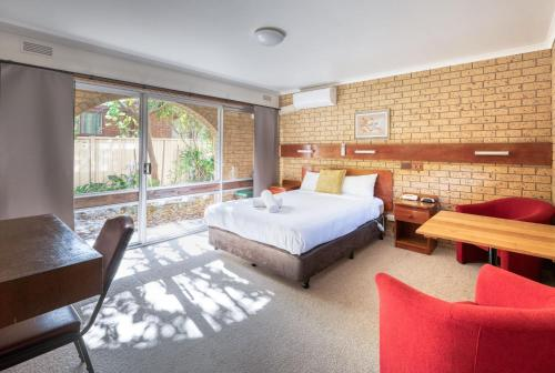 A bed or beds in a room at Colac Mid City Motor Inn