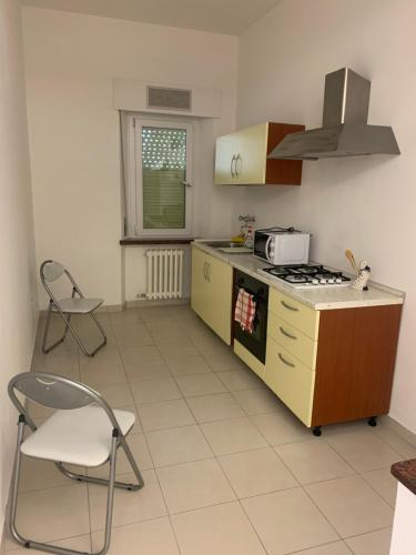 A kitchen or kitchenette at Affittacamere Gambelli