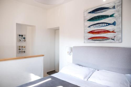 A bed or beds in a room at Hotel Villino Gallodoro