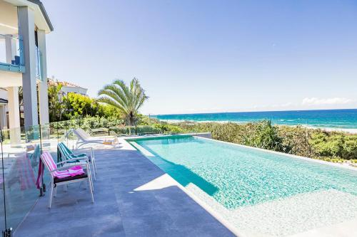 The swimming pool at or near Castaways Beach Escape