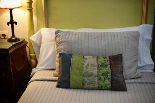 Ein Bett oder Betten in einem Zimmer der Unterkunft Hotel Convento La Gloria