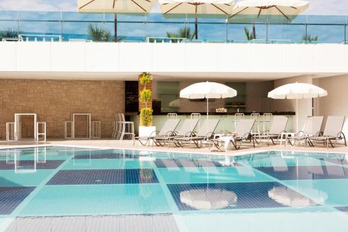 The swimming pool at or near Sunprime C-Lounge - Adult Only