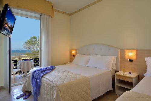 Letto o letti in una camera di Hotel Gaston