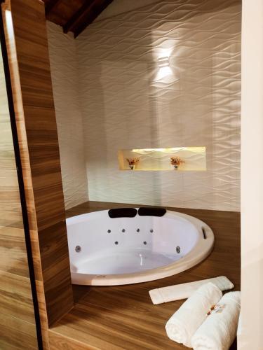 Um banheiro em Pousada Bosque