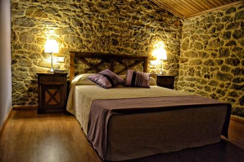 A bed or beds in a room at A Casa do Folgo Turismo Rural