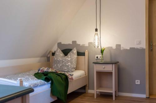 A bed or beds in a room at Landhotel Gutshof
