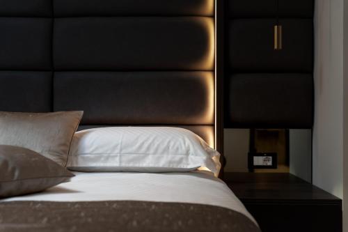 Letto o letti in una camera di Hotel Cittar