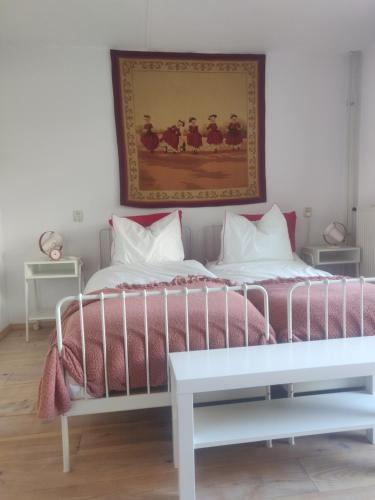 A bed or beds in a room at B&BDésirée
