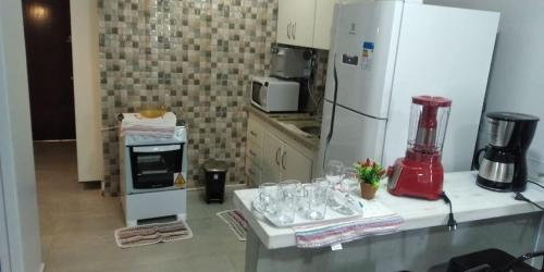 Uma TV ou centro de entretenimento em Apartamento confortável