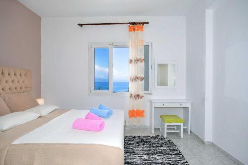 A bed or beds in a room at Villa Baronnos by Konnect, Paxos island