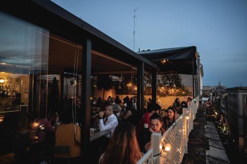 Um restaurante ou outro lugar para comer em Condominio Monti Boutique Hotel