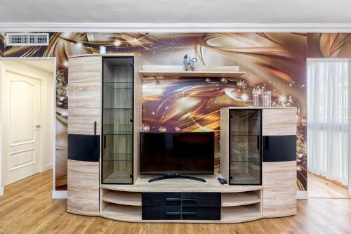 Een TV en/of entertainmentcenter bij Luxury Home On The Beach by Rafleys