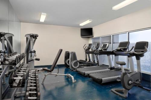 The fitness center and/or fitness facilities at Four Points by Sheraton Hotel & Suites Calgary West