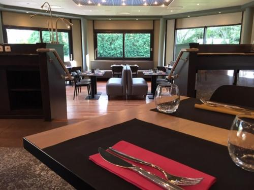 A restaurant or other place to eat at Novotel Bayeux