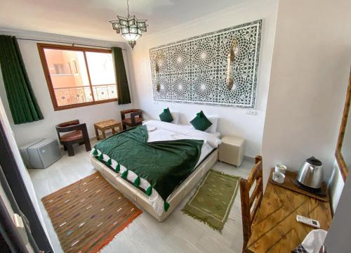 A bed or beds in a room at Hotel Riad Amlal
