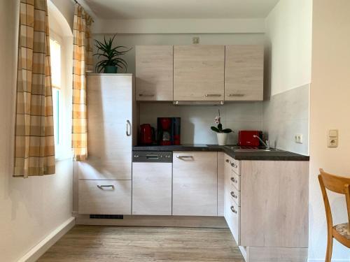 Küche/Küchenzeile in der Unterkunft Ferienwohnung am Malerweg
