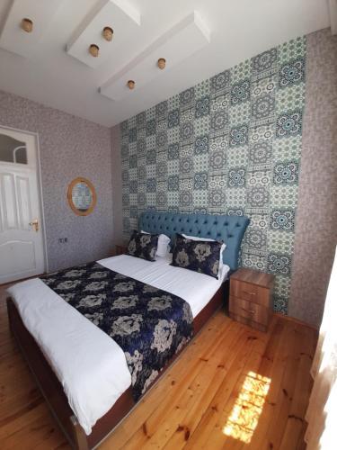 Cama ou camas em um quarto em Raffles Garden Villa