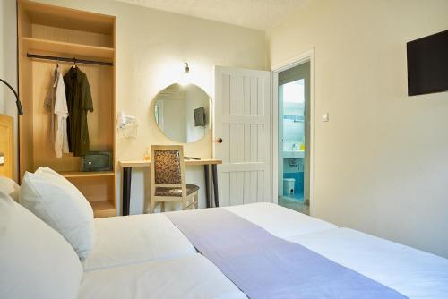 A bed or beds in a room at Sergiani Garden Hotel Apartments