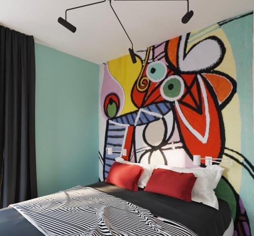 Łóżko lub łóżka w pokoju w obiekcie Art Apartments