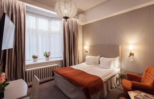 A bed or beds in a room at Hotel Esplanade; Sure Hotel Collection by Best Western