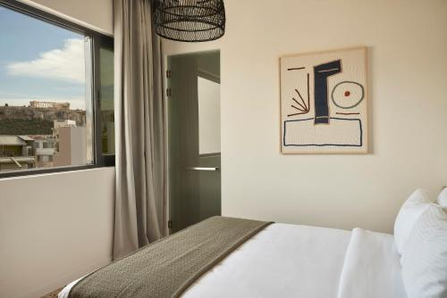 A bed or beds in a room at Vasi