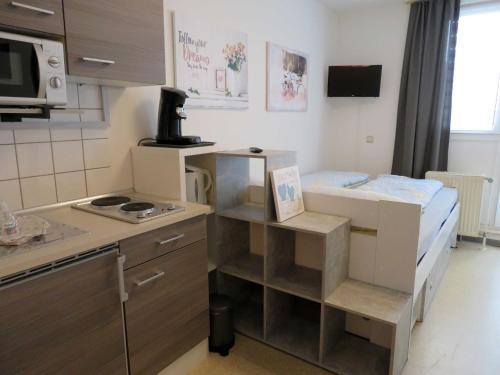 Küche/Küchenzeile in der Unterkunft Ferienwohnung Trier Zentrum, Studio, Apartment, ruhig gelegen